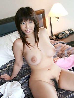 Asian cutie is a model who likes to show off her big tits and her hairy pussy