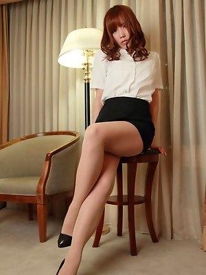Kurumi Kisaragi Asian in short skirt is very proud of her legs