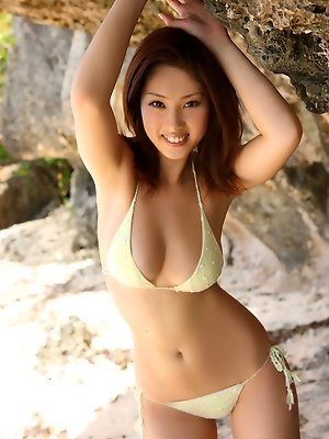 Saucey short haired gravure idol titillates in her bikinis