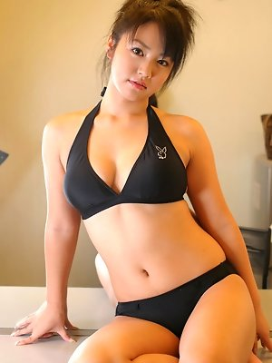 Asian hottie is adorable in her cute glasses and blue bikini