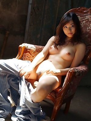 Sexy Asian model removes her coveralls and shows off her excellent tits